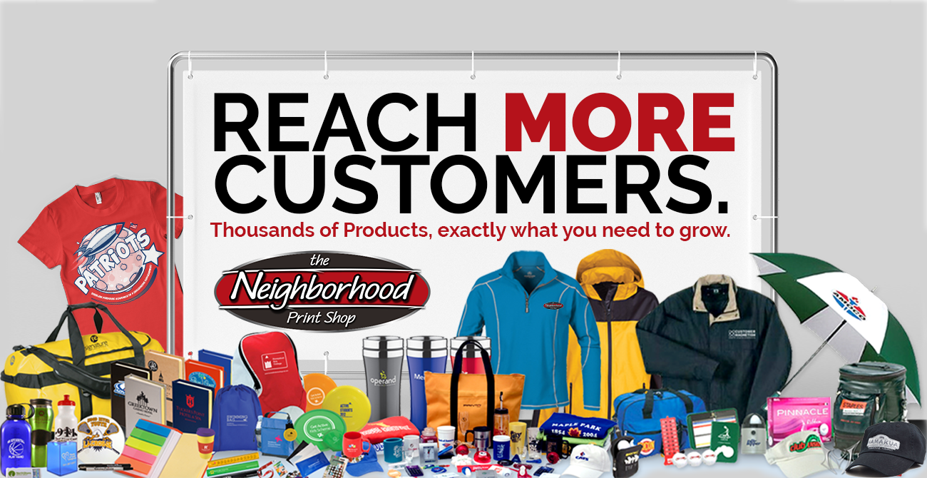 "A large banner mounted in a stand that reads ""REACH MORE CUSTOMERS, thousands of products, exactly what you need to grow."". Around the banner is an assortment of promotional products, hats T-shirts, umbrellas, water bottles, and other items."